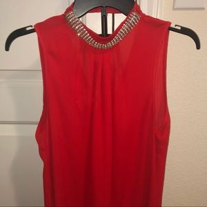 Bright red blouse w/ bejeweled neck line